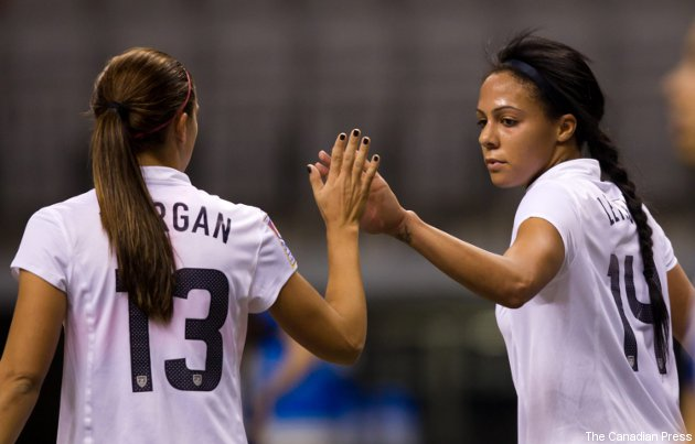 Alex Morgan and Sydney Leroux (right) celebrate one of Leroux's five goals Sunday.
