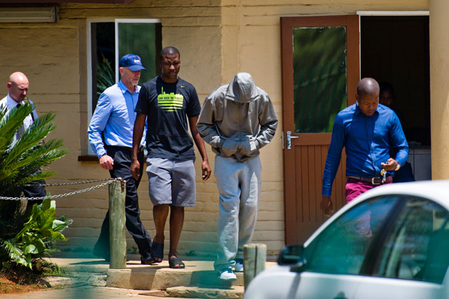Oscar Pistorius leaves the Boschkop Police Station in Pretoria, South Africa on Thursday. (Getty Images)
