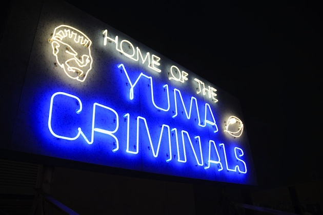 A neon sign for a high school team? When you're the Criminals, it feels right — Criminals in Action