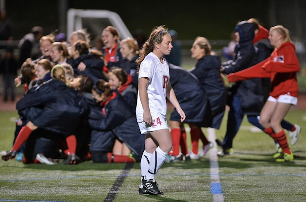 Redondo's Janel De Curtis walks toward her teammates after her penalty was saved in Redondo's shootout loss — The Daily Breeze