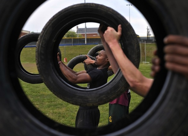 The Louisa High football team completes a strength workout with used tires — The Washington Post