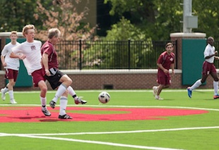 The annual MBA alumni soccer game on top of the school's parking lot — MontgomeryBell.edu