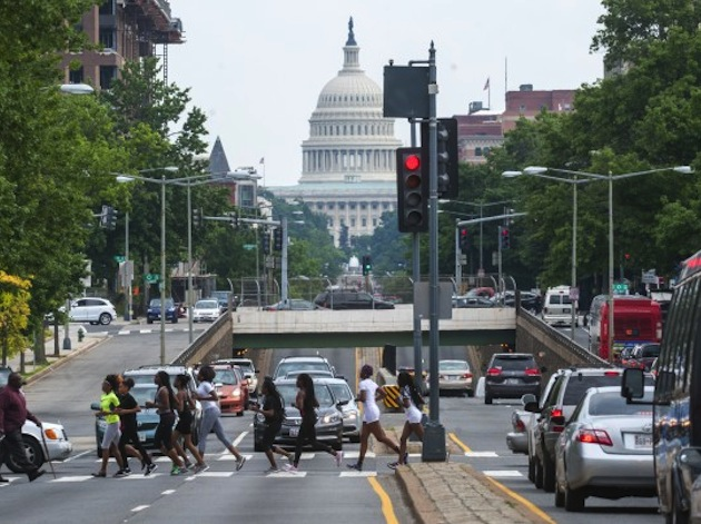 D.C.'s Dunbar girls track team runs through the city on the way to practice -- Katherine Frey/The Washington Post