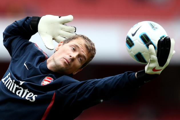 Jens Lehmann makes a save and strikes a pose. (Getty)