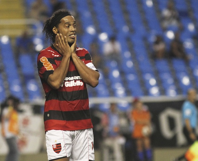 Ronaldinho wishing he had money to rub on his face. (Getty)