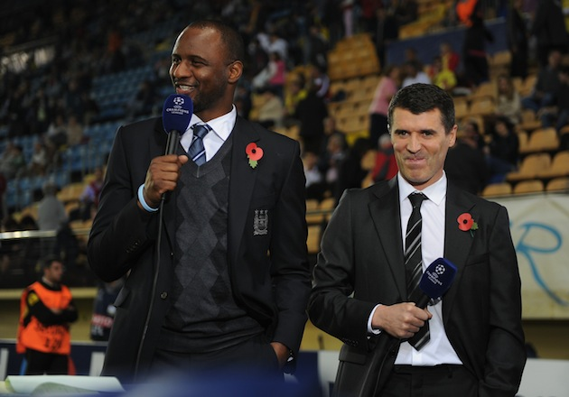 Roy Keane (right) decides how he's going to dismember old nemesis Patrick Vieira (left). (Getty)
