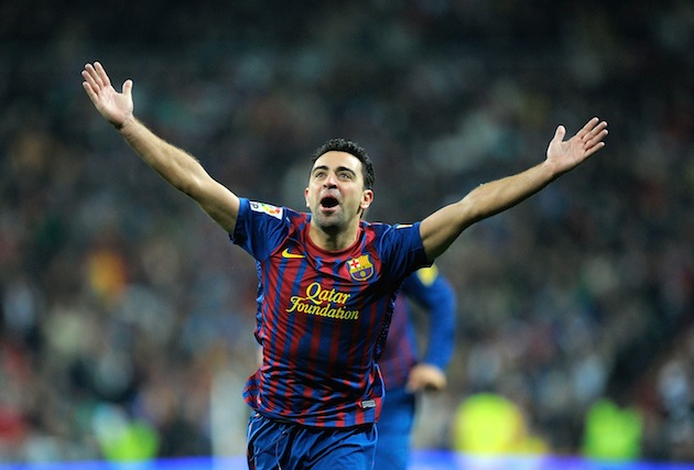 Xavi reacts after spotting Cesc Fabregas. (Getty)