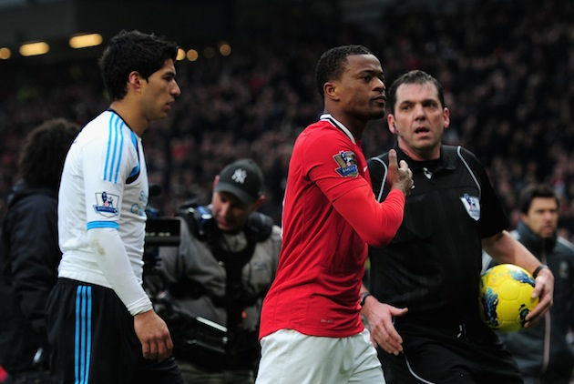 Patrice Evra not so coincidentally celebrates in front of Suarez. (Getty)