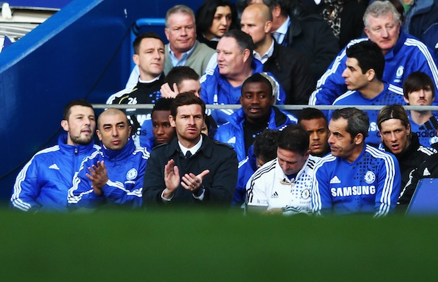 "Andre ""DVD"" Villas-Boas (center) surrounded by people who kinda didn't like him. (Getty)"