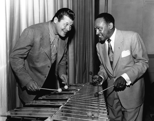 Jack Carson and Lionel Hampton play a xylophone. (Getty)