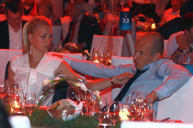 Arjen's wife, Bernadien, makes things worse by pointing out a spot on his tie. (Getty)