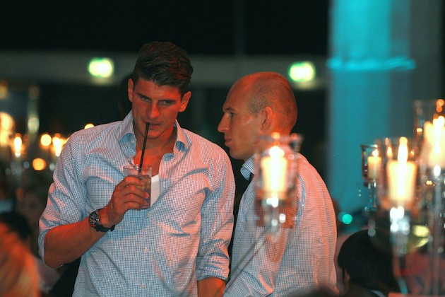 Not even Mario Gomez drinking out of a ridiculously long straw makes him feel better. (Getty)
