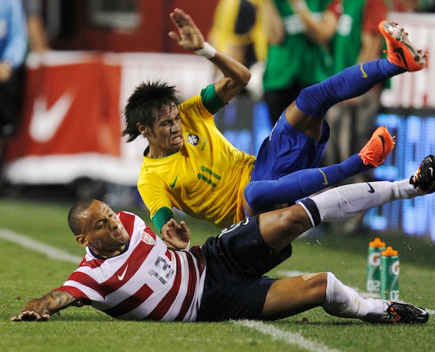 U.S. midfielder Jermaine Jones (bottom) sends Neymar on a magical journey to Pain Town. (Getty)