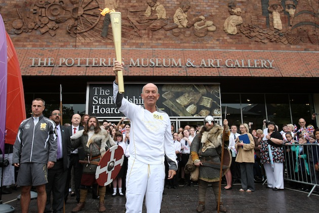 Tony Pulis with the Olympic torch in May 2012. (Getty)
