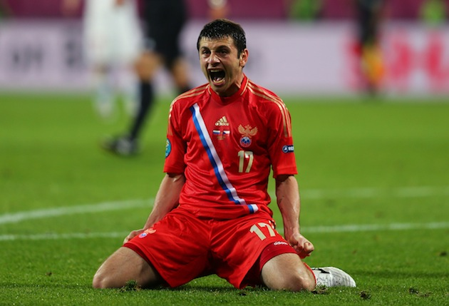 Alan Dzagoev feeling happy. (Getty)