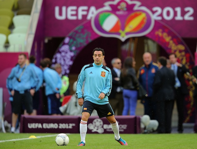 Xavi being violated. (Getty)