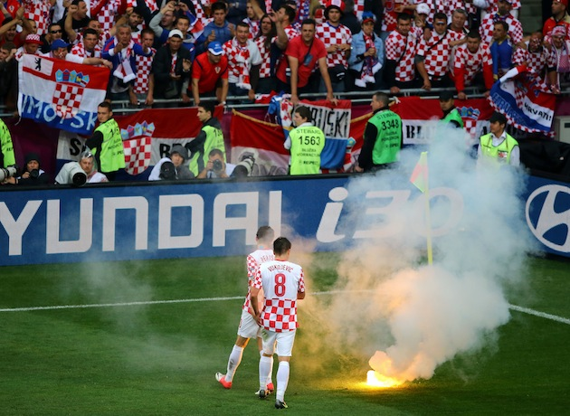 Croatia players about to stamp out a flare. (Getty)