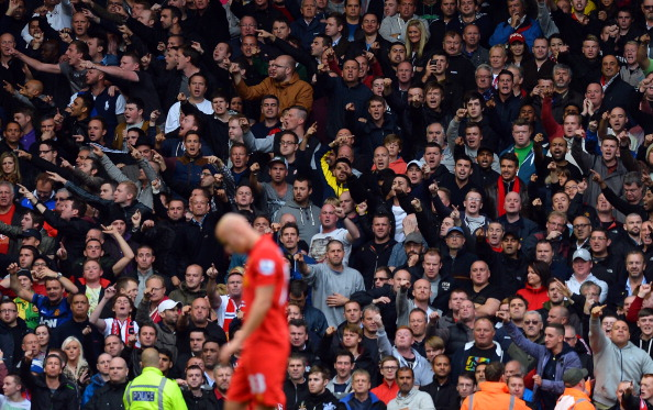 Man United fans helpfully point Shelvey where he has to go. (Getty)