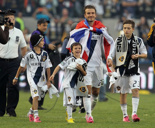 Brooklyn Beckham (far right) walks off the pitch after the 2012 MLS Cup final. (Getty)