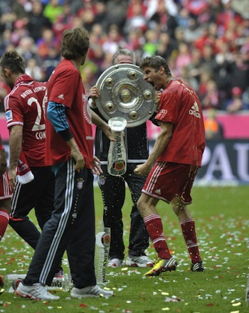Jupp Heynckes uses the trophy as a shield against a psychotic Thomas Muller. (Getty)