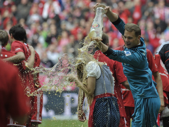 Manuel Neuer douses a lady. (Getty)