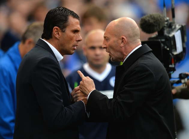 Brighton manager Gus Poyet (left) talks to Palace manager Ian Holloway. (Getty)