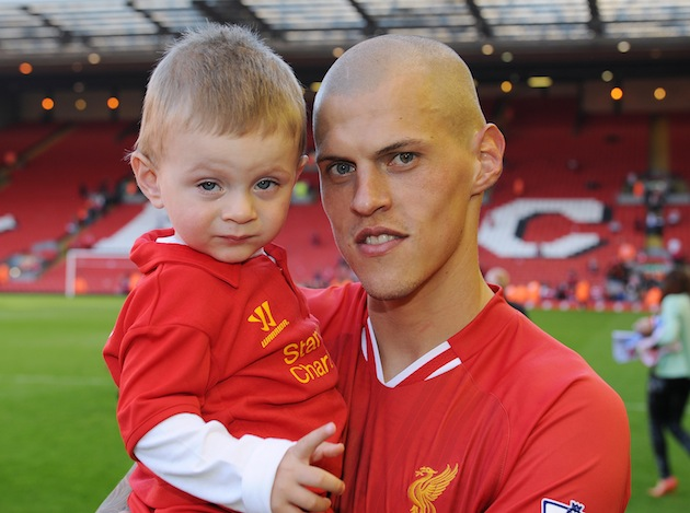 Liverpool's Martin Skrtel with his son. (Getty)