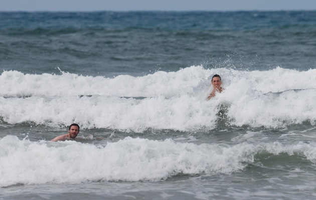 Juan Mata and Fernando Torres play in the ocean. (Getty)