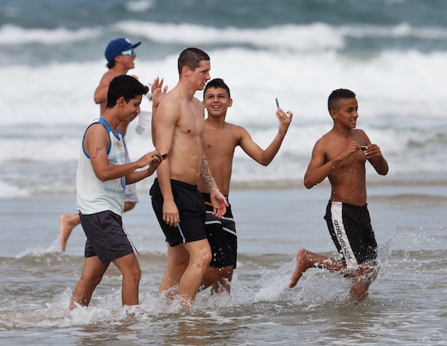 A group of children make fun of Torres for missing a penalty against Tahiti. (Getty)
