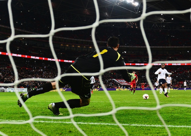 England's Daniel Sturridge scores from the spot against Montenegro. (Getty)