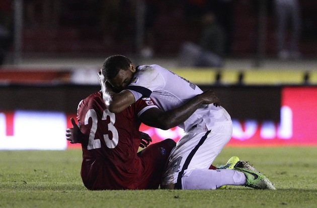 The U.S.'s Terrence Boyd hugs devastated Panama defender Felipe Baloy after the game. (AP)