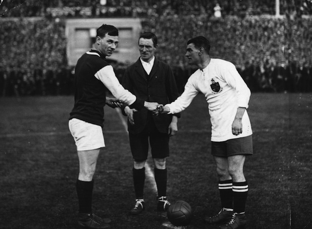 West Ham captain George Kay (left) and Bolton captain Joe Smith shake hands. (Getty)