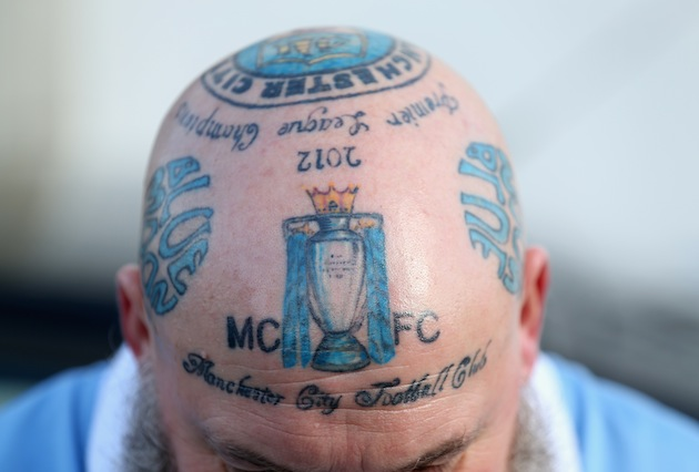 One middle aged Manchester City supporter has club tattoos all over his head [Pictures]
