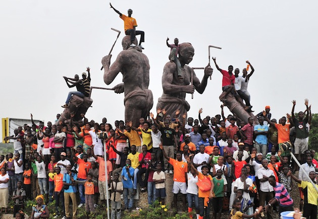 Ivory Coast supporters greet the team at Felix Houphouet Airport in Abidjan. (Getty)