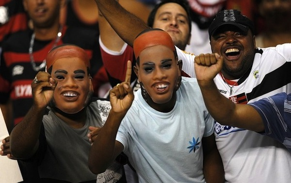 Flamengo fans in Ronaldinho masks. (Getty)