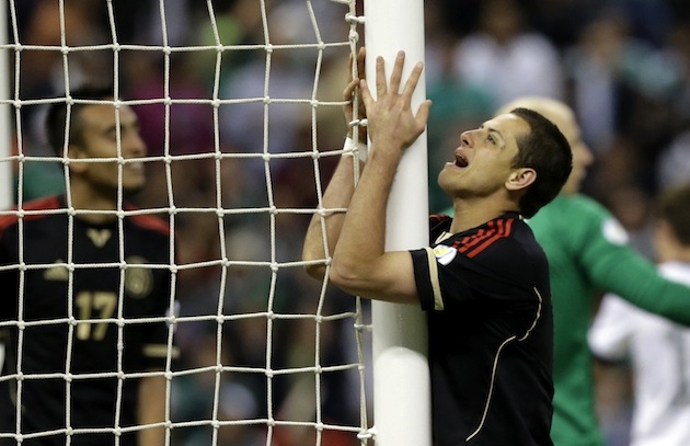 Chicharito cries out as he makes love to the post. (AP)