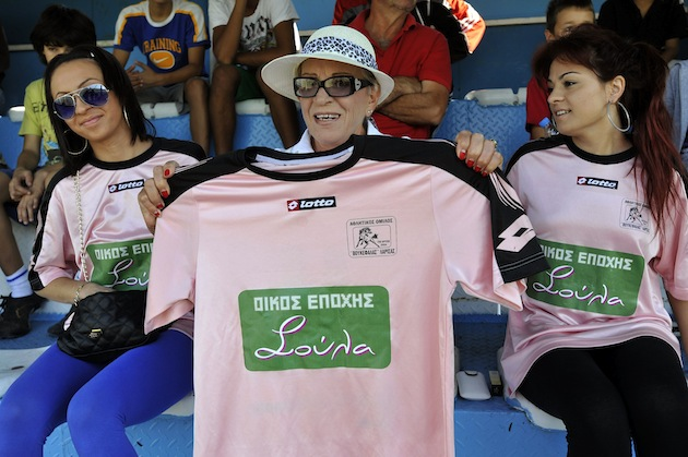 Brothel owner Soula Alevridou (center) holds up the new shirt. (AP)