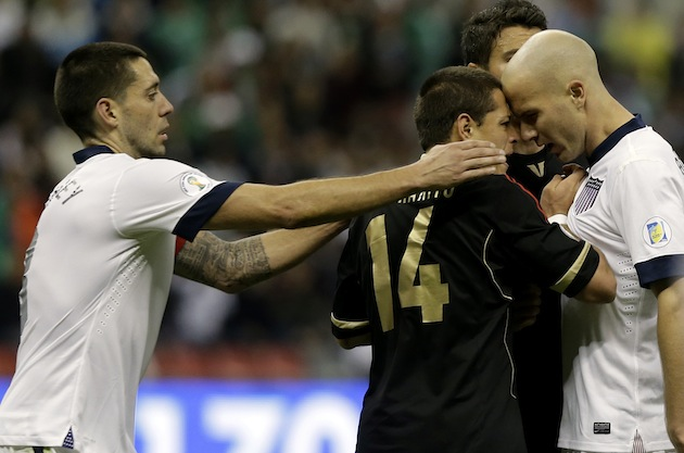 Clint Dempsey saves Chicharito's life. (AP)
