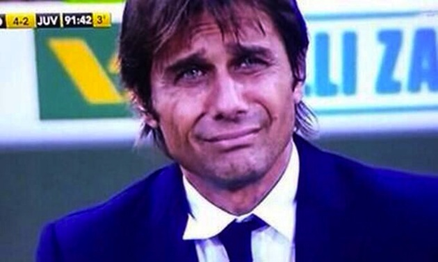 Juventus coach Antonio Conte flashes the saddest smile after Fiorentina beat them 4 2