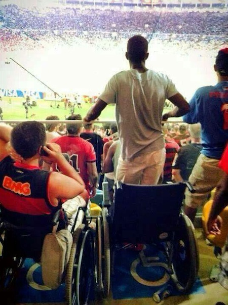 Its a miracle! A wheelchair bound Flamengo fan manages to get off his chair during a match [Picture]