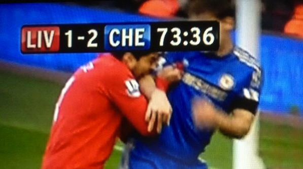 Luis Suarez bites Branislav Ivanovic, the second time he's bitten an opponent during a match