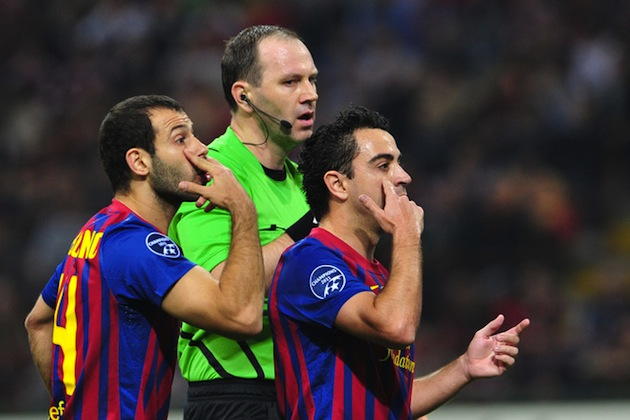 Xavi (right) would like you to see things his way. (Getty)