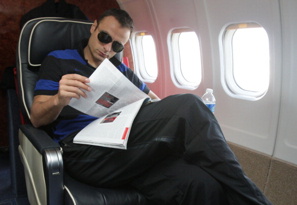 Dimitar wears sunglasses instead of shutting the window shade. (Getty)