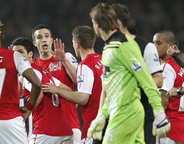Robin van Persie waves to Tim Krul in the most irritating way possible. (Getty)