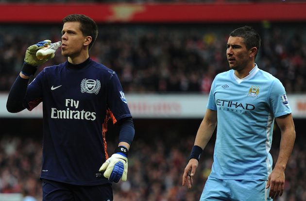 Szczesny pretends to take a swig. (Getty)