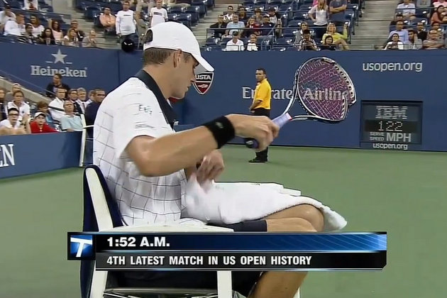 John Isner smashes his racquet in the fifth set of Sunday's match (screengrab via YouTube)