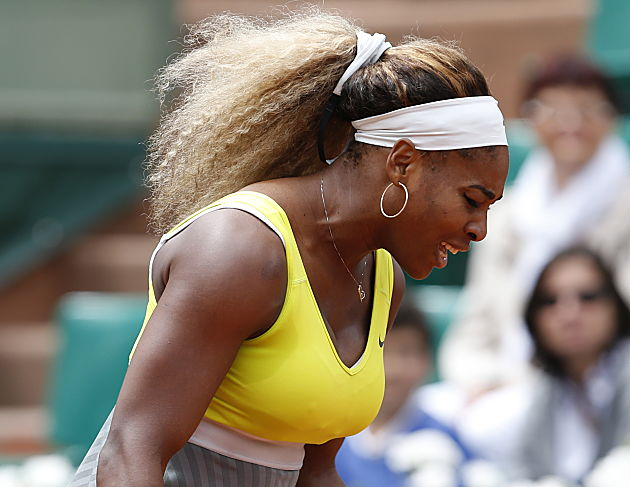 A punchless Serena Williams is out of the French Open in the second round. (AP Photo/Darko Vojinovic