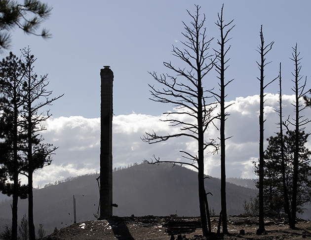 A chimney of a home destroyed by the Fourmile Canyon fire. (Photo: AP Photo/Jae C. Hong, Pool)