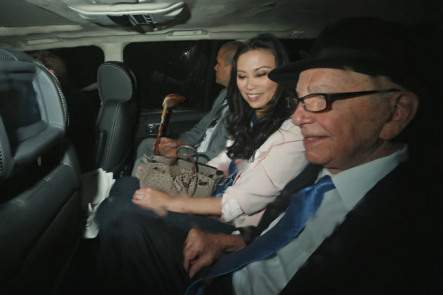 Murdoch, right, wife Wendi Deng and son Lachlan are driven to the Leveson Inquiry in London, April 26, 2012. (Matt Dunham/AP)