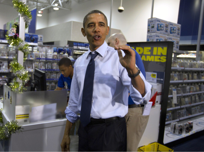 President Obama shops for Christmas gifts at Best Buy in Alexandria, Va., on Dec. 21, 2011. (Carolyn Kaster/AP)
